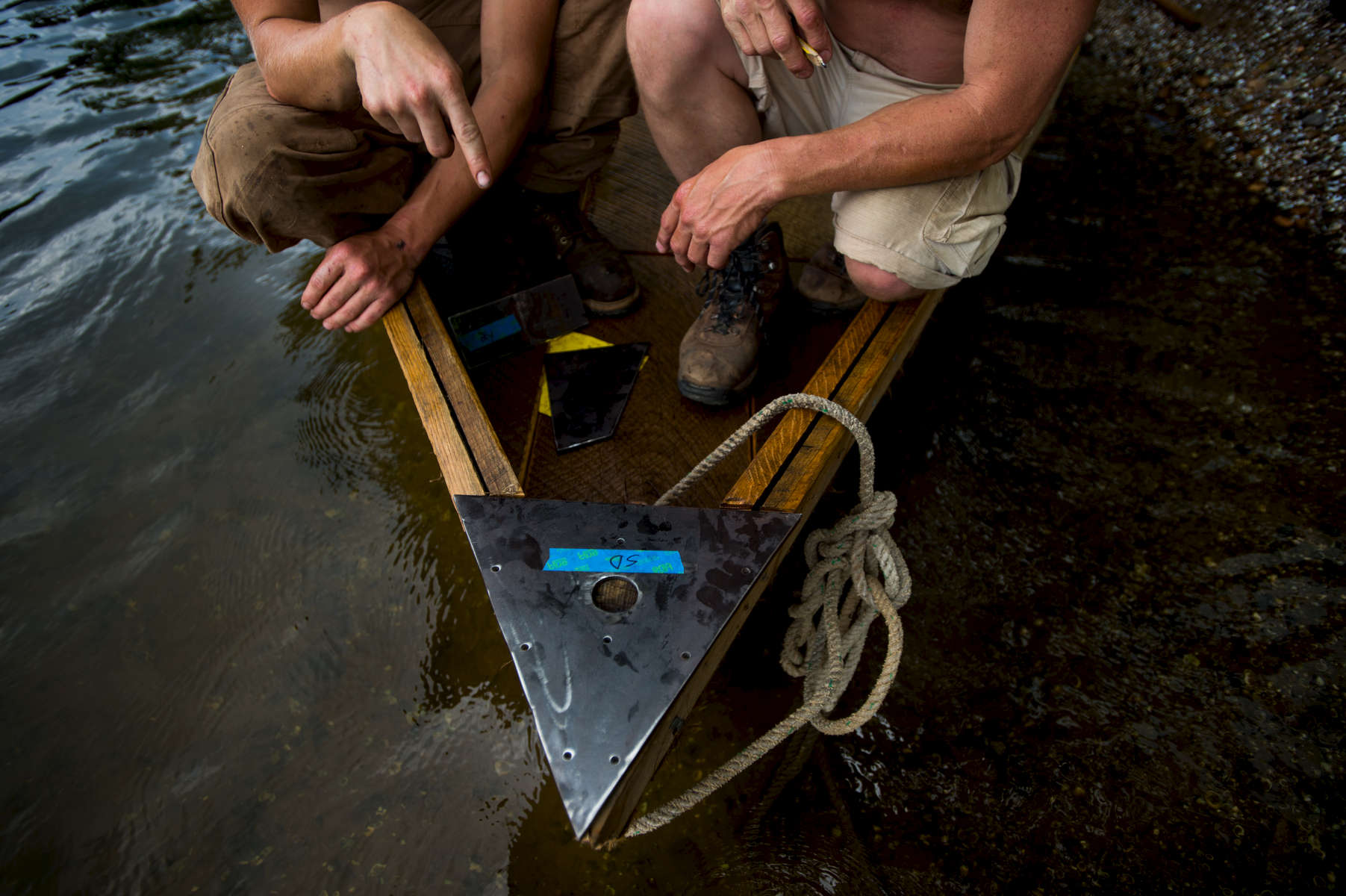 Isaac Schumacher and his father, Robert, set the sweep mount on the Lizzie Langley, a batteau they've been building since January. {quote}I've definitely spent more time with Isaac working on the boat than I will floating on the boat, and I'm perfectly okay with that,{quote} Robert Schumacher said.