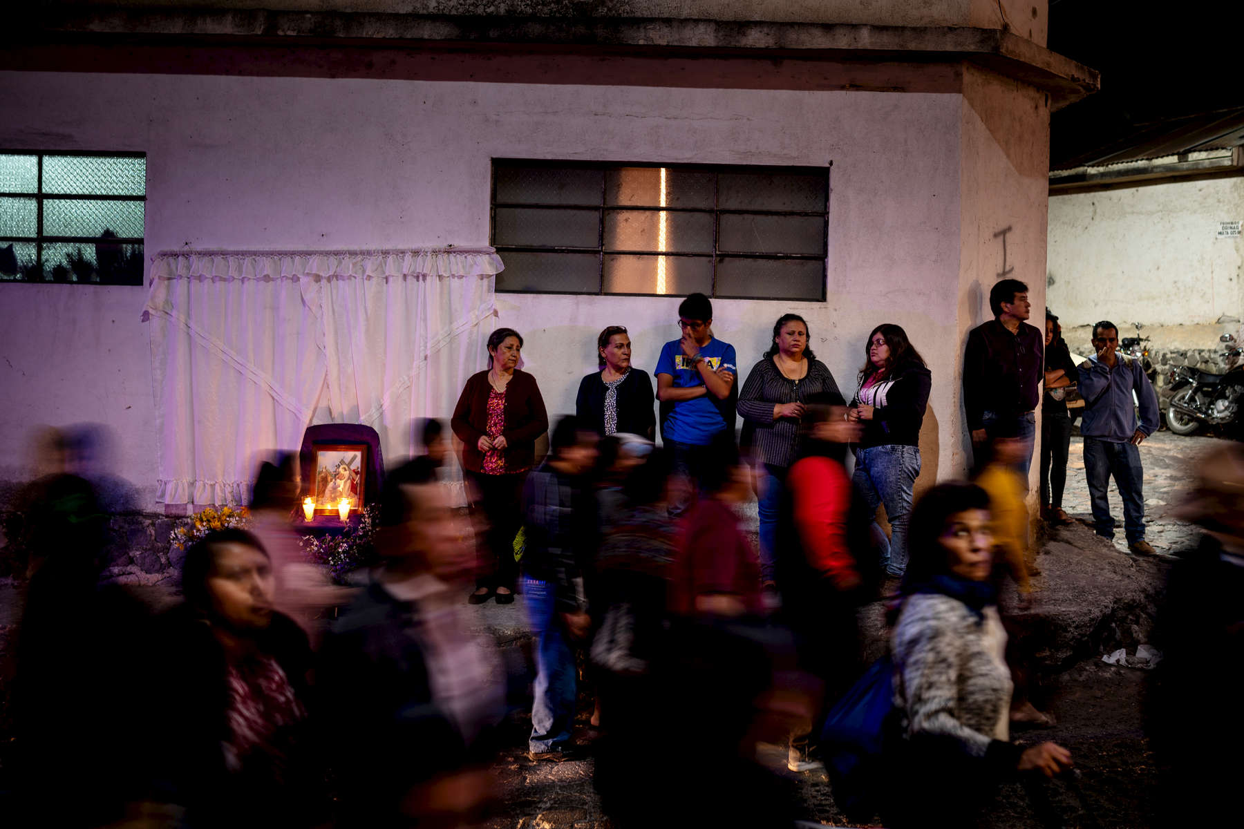 Catholic parishioners await the arrival of the and a with a  representation of Jesus during a procession to each of the Stations of the Cross during Lent, April 5, 2019, in Panajachel, Guatemala.