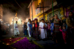 During a procession on April 5th, Catholic parishioners walk past an alfombra made with different flowers on Calle de los Arboles.