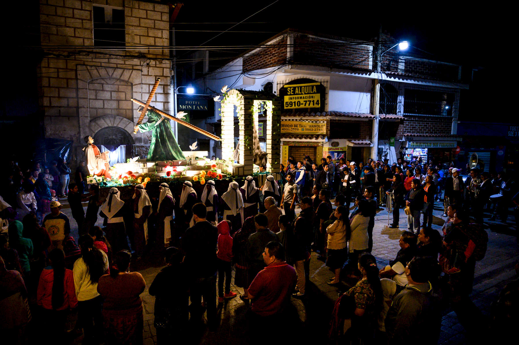 Worshipers gather near the Iglesia San Francisco in Panajachel at the end of a procession on April 12th, 2019 in Panajachel, Guatemala.