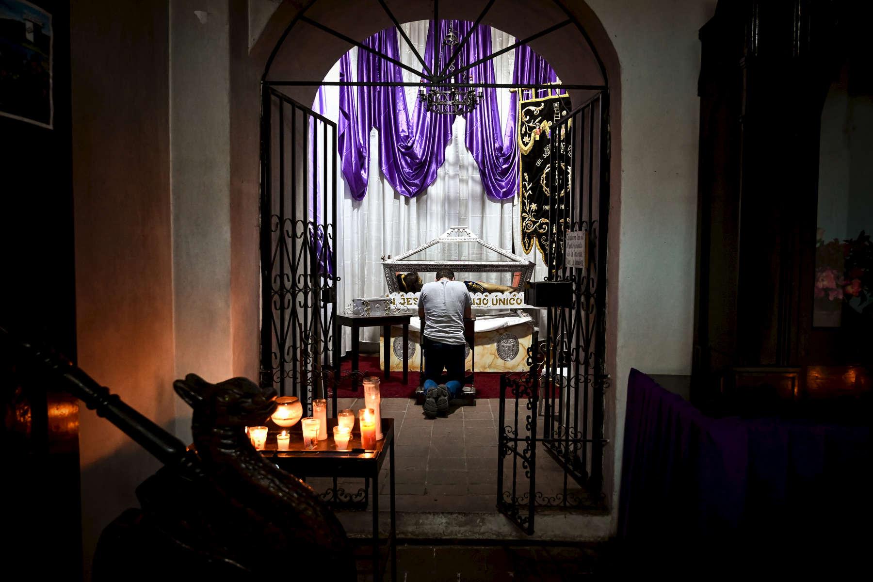 A man prays at the Catholic Church on April 18, 2019.