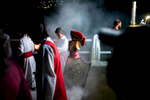 A boy dressed as a Roman Centurion escorts the procession on Maundy Thursday in Panajachel, Guatemala.