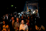 Catholic parishioners walk behind the anda during the procession on Maundy Thursday.