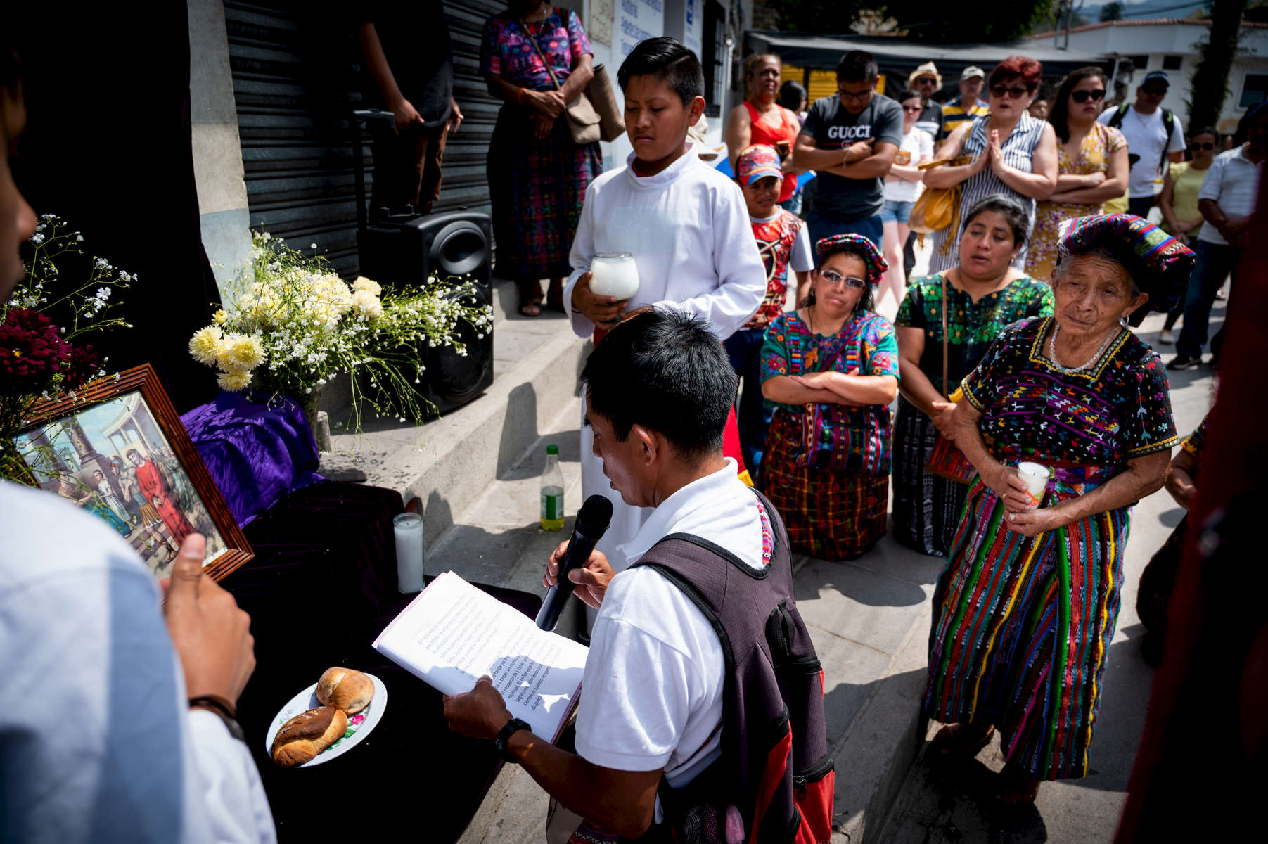 Parishioners listen as a prayer is offered during a procession on Good Friday in Panajachel, Guatemala.