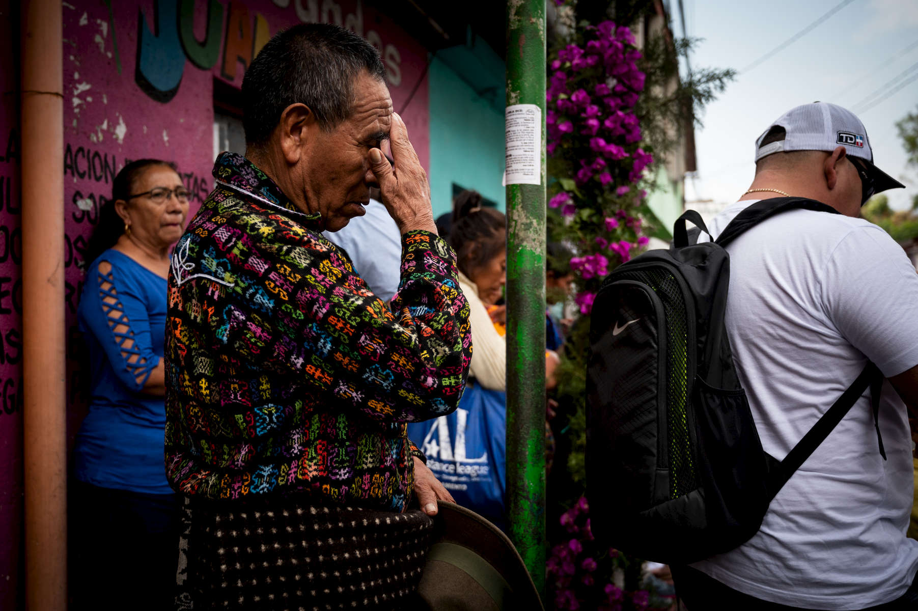 A man, prays during the procession.