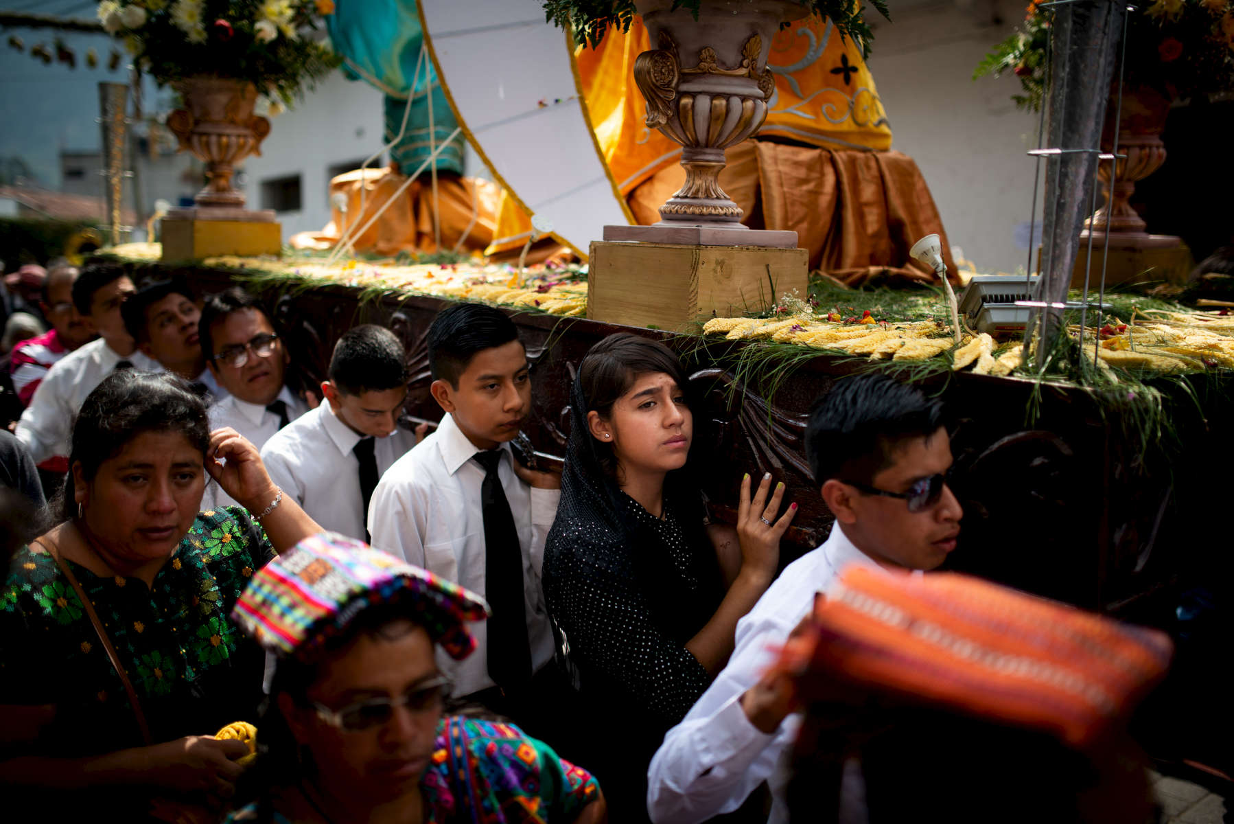 Parishioners carry the anda through the streets of Panajachel, Guatemala.