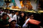 Parishioners carry the anda through the streets of Panajachel, Guatemala.
