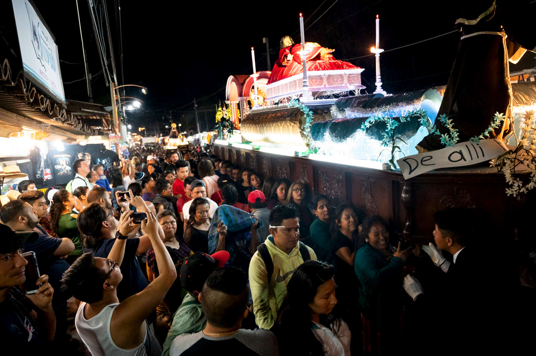 As night fell, the final procession of Holy Week and the Lenten season wove its way through Panajachel. Crowds lined the streets as more than 30 volunteers carried the ornate anda with a representation of the body Jesus Christ.