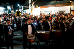 During each procession, a band follows closely behind, providing music for the ceremony.