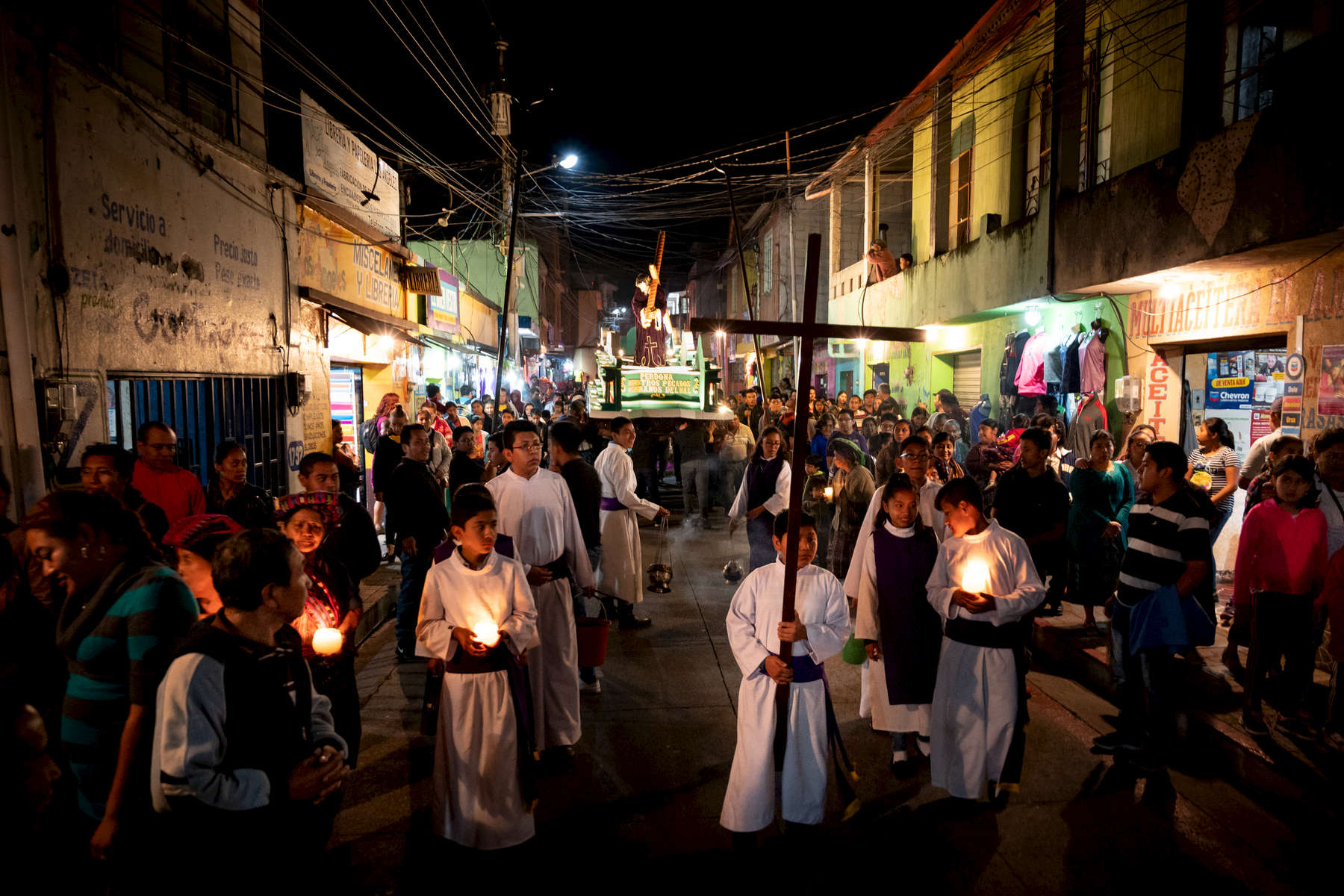 Catholic parishioners carry an anda, or float, with a life-size representation of Jesus during a procession to each of the Stations of the Cross during Lent, April 5, 2019, in Panajachel, Guatemala.