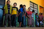 Students at an elementary school in the village of Nueva Esperanza wait in line before picking up school supplies for the year. Mission Guatemala provides a years' worth of supplies for each student in the school.