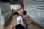 Kids run through alleys in the village of Chutinamit. The village was relocated to its current location after Tropical Storm Agatha in 2010. The residents are still living in transitional housing nearly three years later.