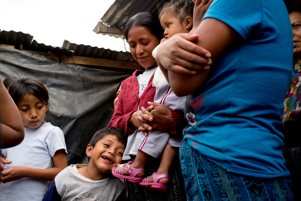 A family is seen in the village of Chutinamit. The village was relocated to its current location after Tropical Storm Agatha in 2010. The residents are still living in transitional housing three years later. Mission Guatemala provides familes in Chutinamit with beds, water filtration systems and medical care at their clinic.