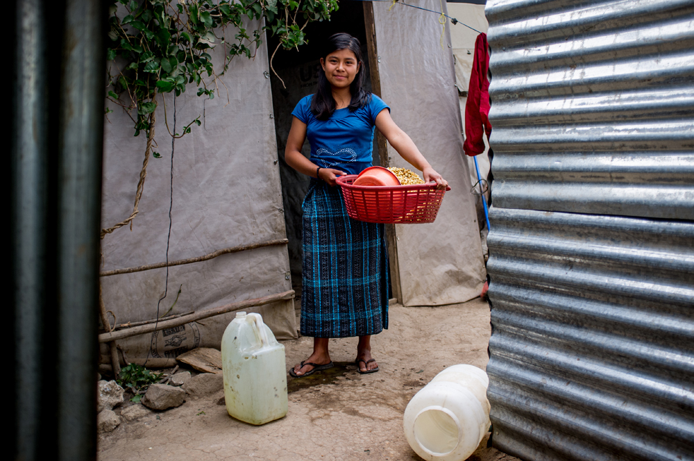 A young woman from the village of Chutinamit stands for a portrait in early 2013. The village was relocated to its current location after Tropical Storm Agatha in 2010. The residents are still living in transitional housing three years later. Mission Guatemala provides familes in Chutinamit with beds, water filtration systems and medical care at their clinic.