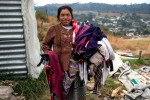 A woman from the village of Chutinamit holds her laundry in this photograph from January 2013. The village was relocated to its current location after Tropical Storm Agatha in 2010. The residents are still living in transitional housing three years later. Mission Guatemala provides familes in Chutinamit with beds, water filtration systems and medical care at their clinic.