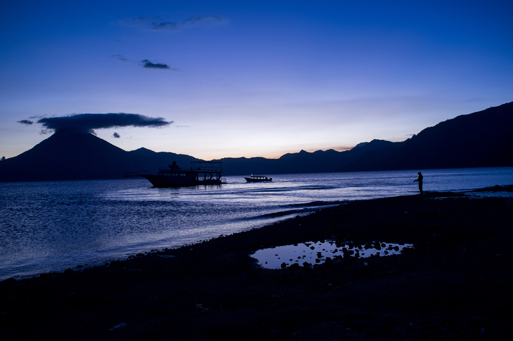 A lone fisherman is seen along the shore of Lake Atitlan in Panajachel, Guatemala.