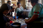 Mothers from the village of Xepec help prepare the first meal for the school's Mission Guatemala-run feeding program.
