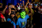 Students, wearing costumes and masks in celebration of Carnival, dance the afternoon away in the village of Nueva Esperanza.
