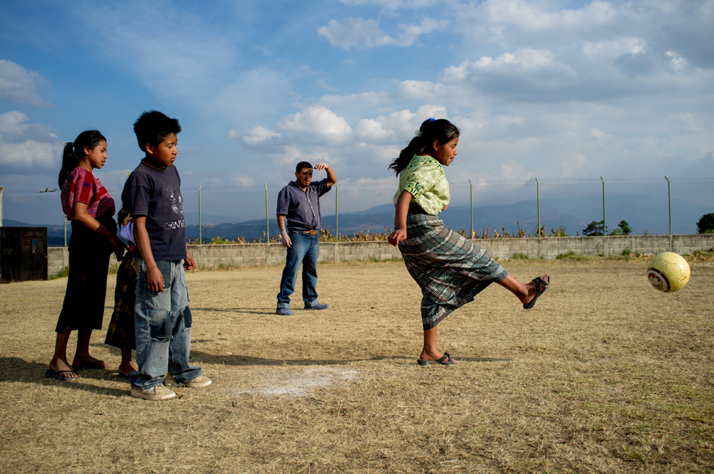 Students play a game of kickball at an elementary school in the village of Caliaj.