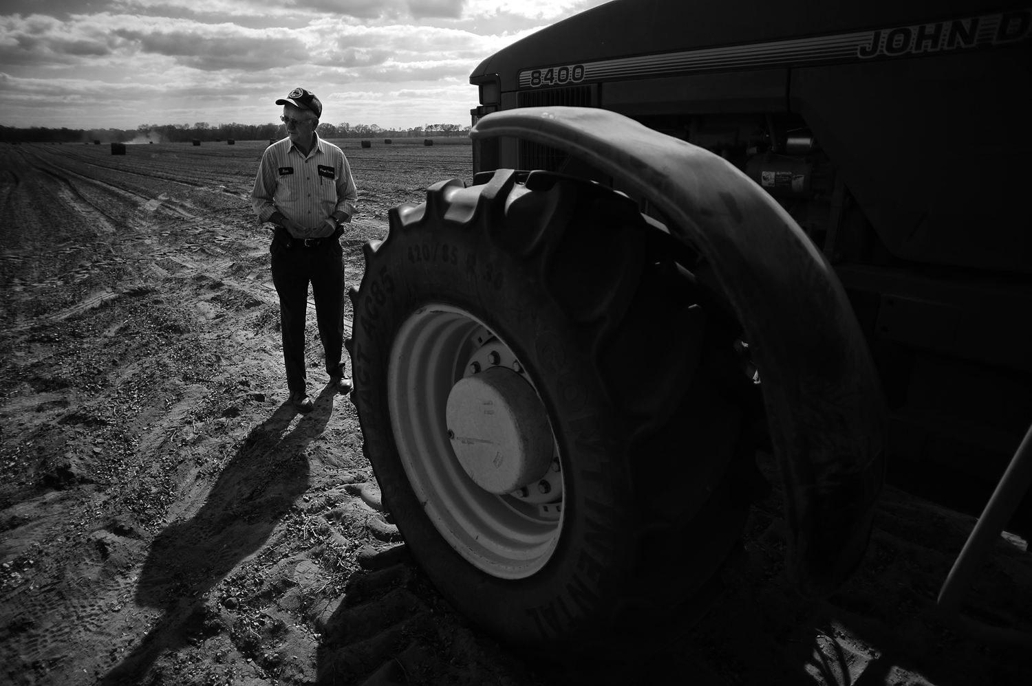Ben Floyd, a peanut farmer from Jackson County, Fla., stands near one of his John Deere tractors as he waits to begin work in late October 2011.