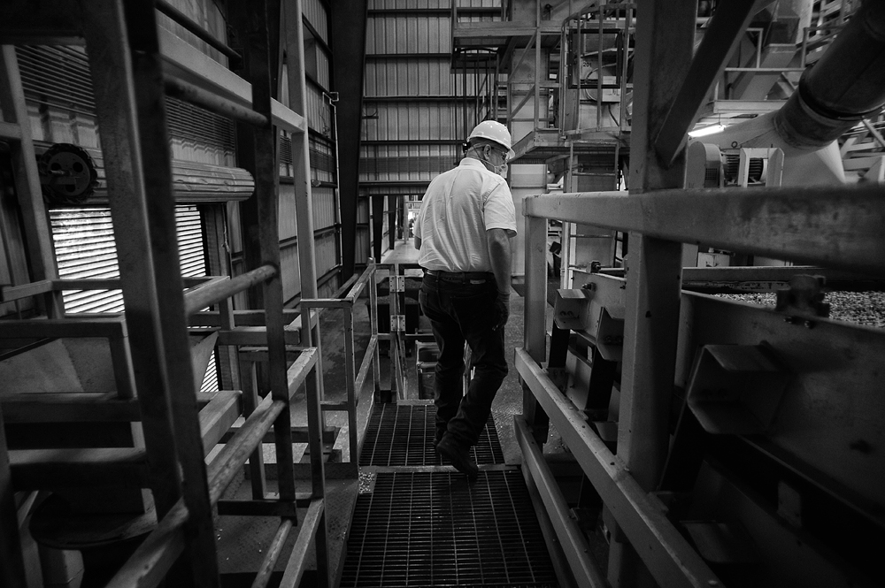 An employee of Golden Peanut Company navigates the aisles in between shelling machinery.