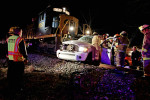 Emergency personnel work to remove a victim from a truck December 20, 2009 after the truck was struck by a train in Ashford. No one was seriously injured.