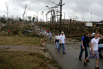 Students from Enterprise High School and residents from the surrounding neighborhood walk down a road near the school shortly after a deadly tornado touched down March 1, 2007.