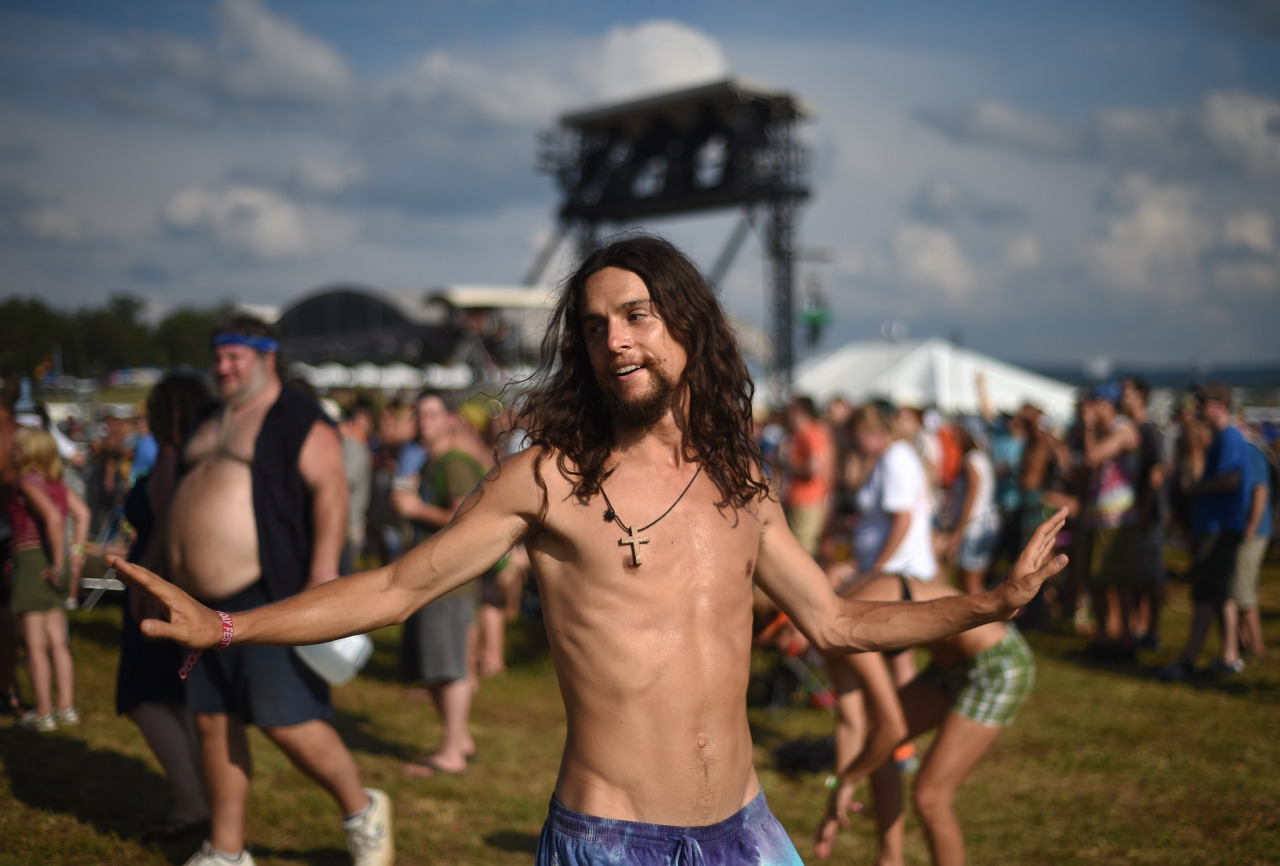 A man, who goes by the name Theophilus, dances to music at the Lock'n Music Festival in Nelson County, Va. (Photo by Max Oden/The News & Advance)