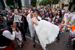 People dressed as zombies surrounded newlyweds John Andrews and Shelley Basinger, a WSET TV anchor, during their wedding photo shoot. People in the wedding party were unaware of the scheduled {quote}Zombie Walk{quote} when plans were made for group portraits downtown.