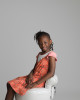Portait of a beautiful girl sitting on a chair. Nemi specialises in child photography in London.