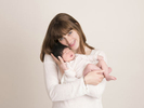 Mum and newborn baby portrait in a London studio.