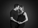 A sensual black and white couples' maternity photography session in Nemi's London studio.