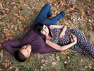 A couples' outdoor pregnancy photography session in a London park.