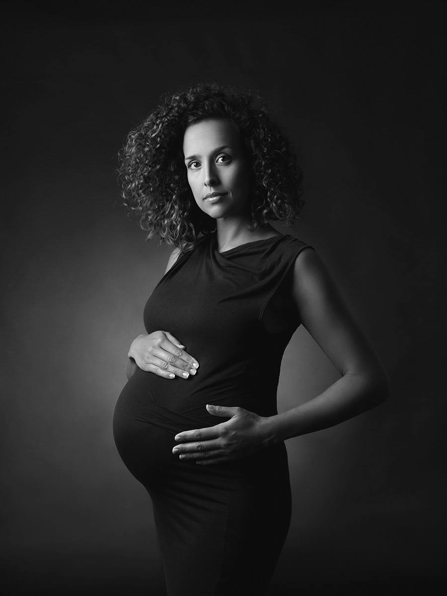 A black and white studio maternity portrait by London's award-winning photographer.