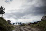 People walk along a road between two major villages Salleri and Nele in lower Solu Khumbu District of Nepal.