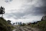 People walk along a road between two major villages Salleri and Nele in lower Solu Khumbu District of Nepal.