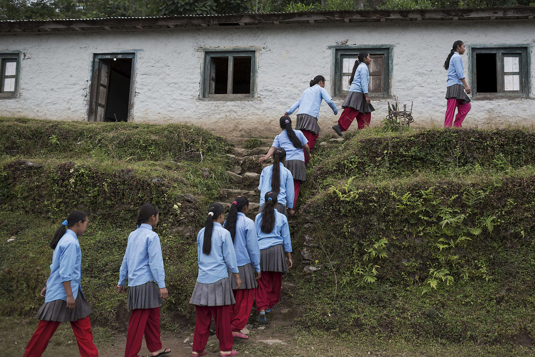 Students walk in grades to their classrooms at Birendrodroya Higher Secondary School in Mukli, lower Solu Khumbu District, Nepal. AHF through its partner REED has provided teacher-training programs for the schools teachers while a number of the students also received scholarships.