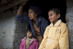 Gita Bhujel and her two daughter Delisha and Babita look out from their home in Nele a small village in the lower Solo Khumbu region of Nepal. Delisha Bhujel was a successful recipient of an AHF scholarship which assists her Mother cover the school fees.