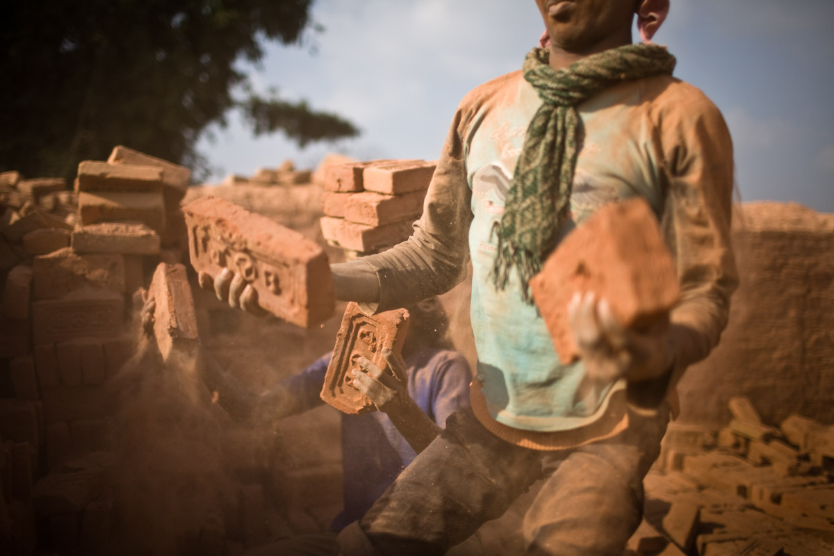 Workers collect bricks from a brick kiln in Bhaktapur.