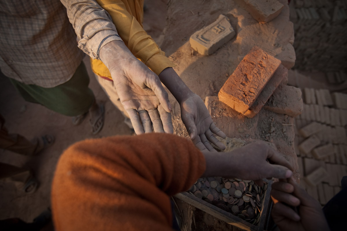 After each load of bricks every worker receives a token which at the end of the day is counted and paid accordingly.