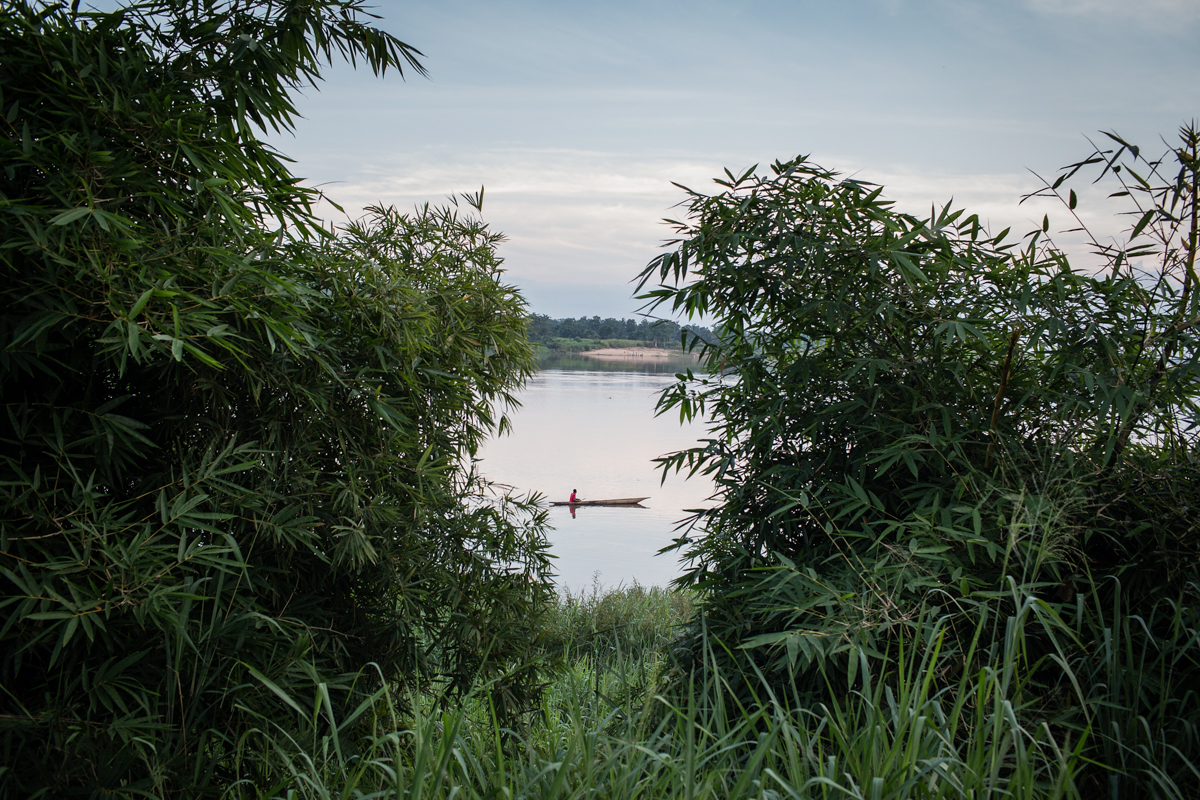 Men paddle canoes along the Congo River which divides Central African Republic and Democratic Republic of Congo. In March 2013 the Seleka rebels overthrew Preisident Bozize and took the capital Bangui. Hearing of the Seleka approaching thousands of young men escaped across the Congo River into DRC in fear of being killed by the Seleka Rebels.