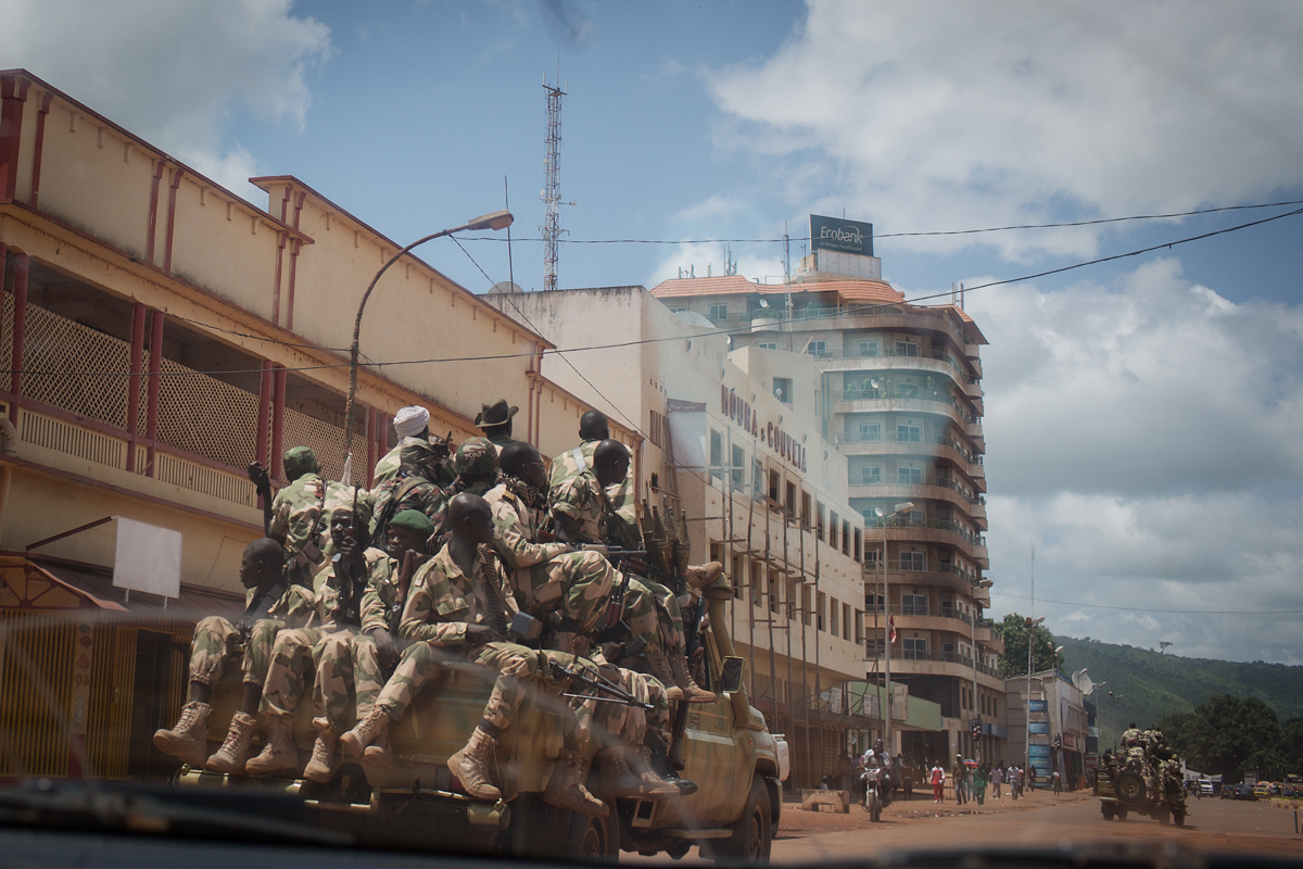 A convoy of Seleka rebels drive through downtown Bangui. Since the Seleka rebels overthrew the President in March the capital has been wracked by violence and uncertainty. While there is technically a ceasefire in place between the Seleka rebels and the MONUC peace keeping force, many sites including the market are still filled with armed Seleka rebels.