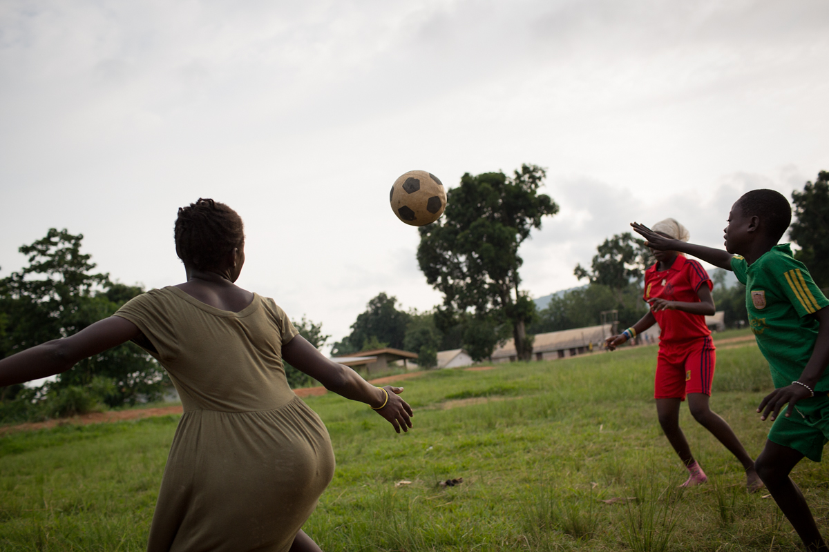 Children play football in the late afternoon in Bangui.