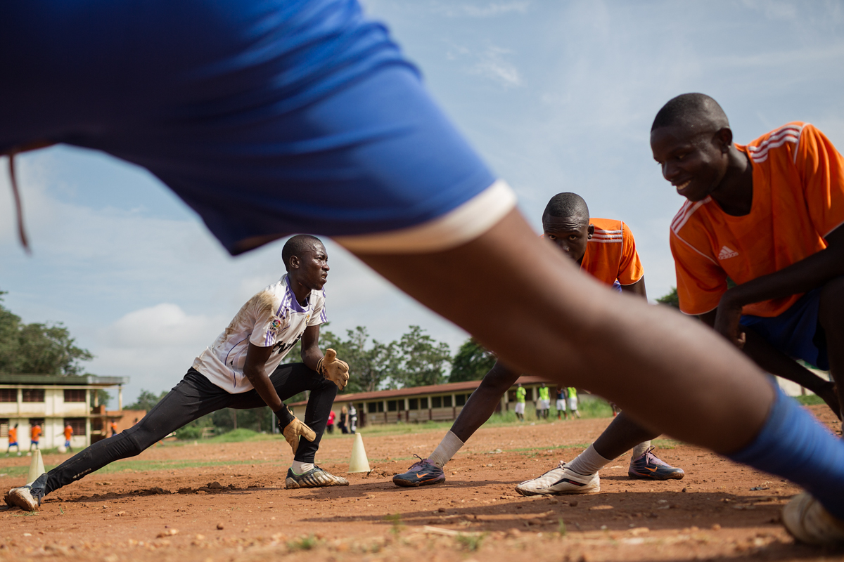 Football teams sponsored by the SOS Childrens Village train at a field in downtown Bangui. The teams are made up of a mixture of young men from the SOS youth houses and also young men from the wider community.