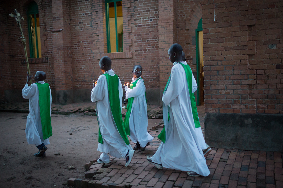 Alter servers prepare for a Catholic mass service at dusk outside Bangui. Very few members of the Church come to evening mass since the Seleka rebels took powerin March 2013. It is still considered very unsafe to be outside at night time in Bangui.