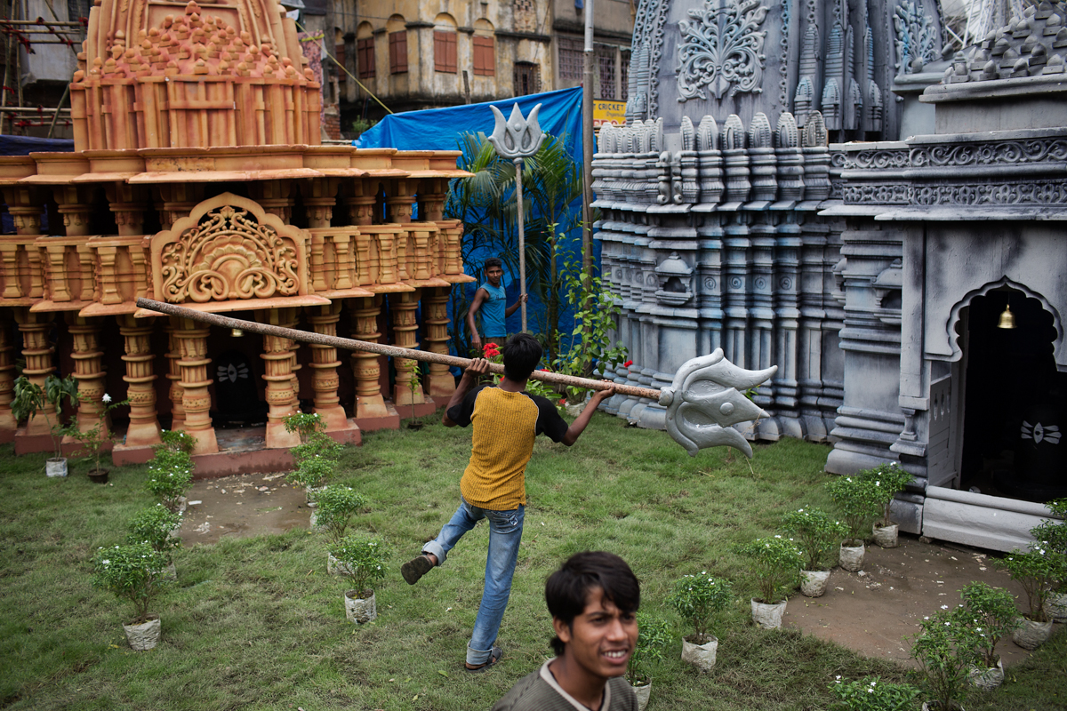 Labourers add the last minute touches to the Kanan park pandal a day before the famous pandal hopping begins.