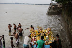 On dashami, the final day of the Durga Puja labourers carry a massive Durga statue to be immersed in the Hooghly River. Most labourers are Muslim farmers from rural West Bengal who come to the capital for work during the festival season.