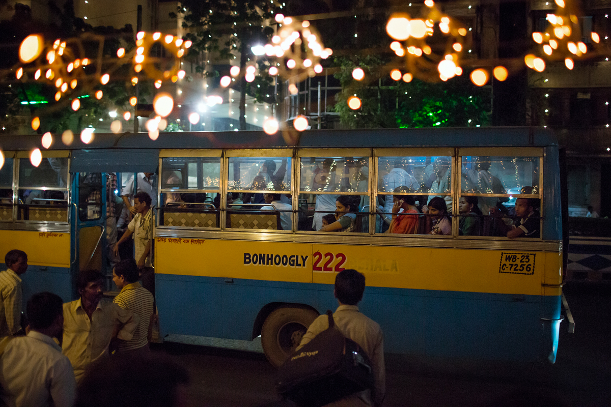 A bus picks up passangers returning home after a final evening of pandal hopping across Calcutta.