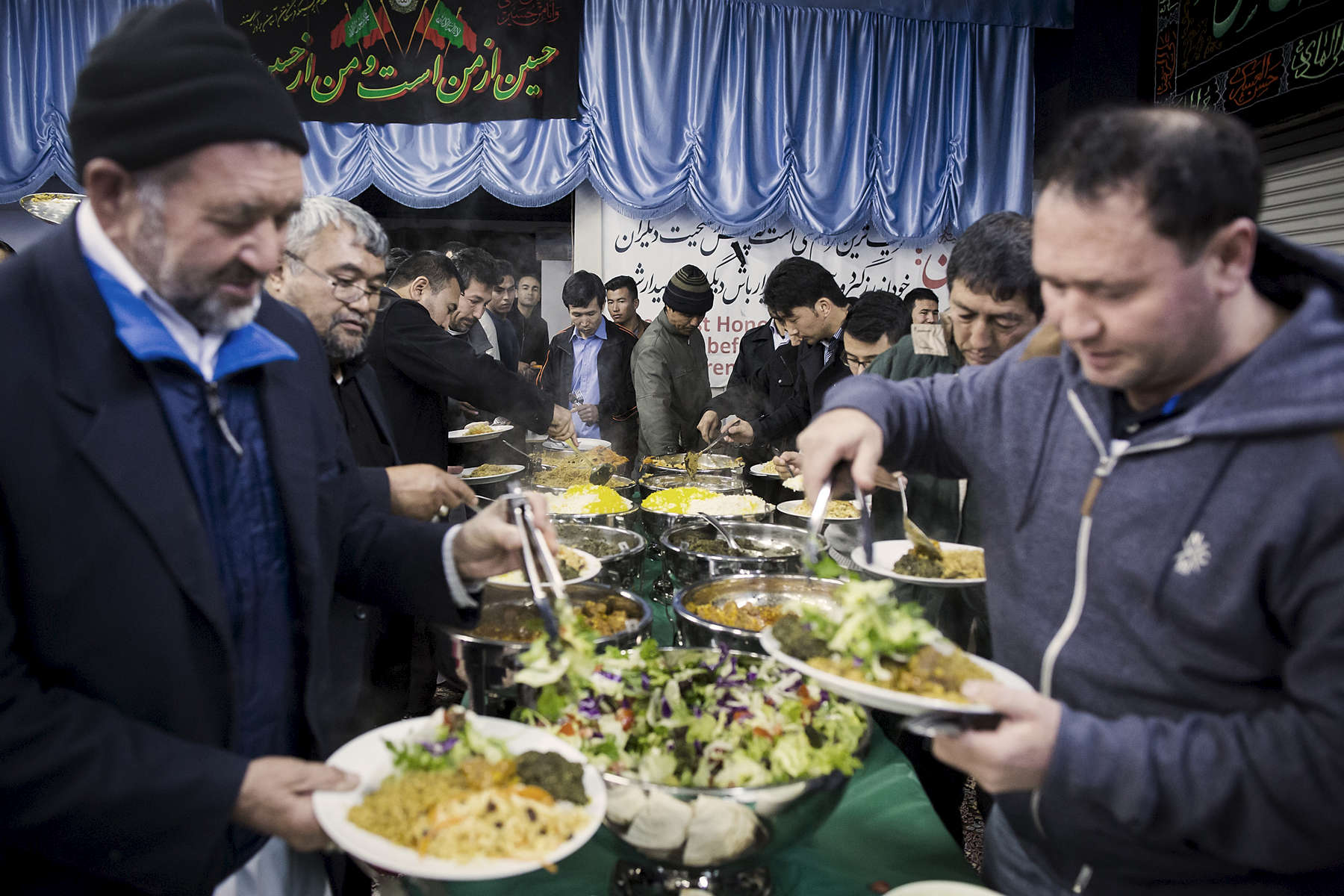 At the Ershad Islamic Centre in Lidcombe, the Hazara community share an iftar meal to break their fasting. As mostly Shiite Muslims, the Hazara are targets for violence by extremist Sunni Muslim groups such as the Taliban and Lashkar-e-Jhangvi in both native Afghanistan and Pakistan. Shia Muslims in Afghanistan make up approximately 15% of the population.