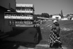 A mother makes her way to the Port Moresby General Hospital. Pom General- as it's commonly referred to- is extremely under-resourced, yet staff are expected to attend to the capital's growing population, as well as emergency cases from neighbouring provinces.